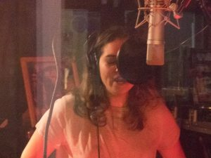 Spanish language version of 'Bad Guys' by Gone Marshall being recorded in Florida, USA